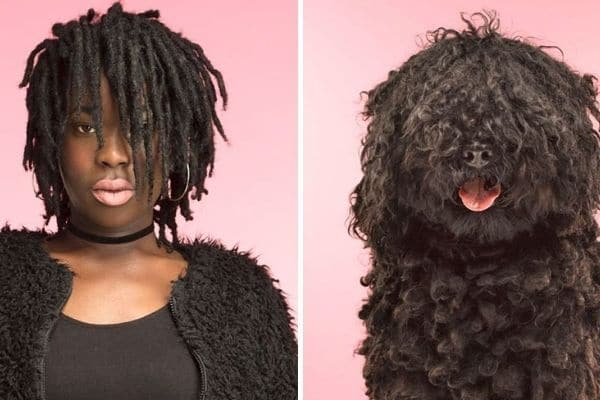 black-woman-with-dark-hair-next-to-black-haired-dog